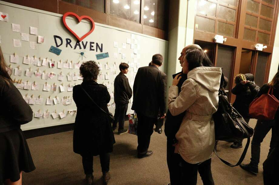 A crowd gathers around a display with handwritten notes after the memorial for Draven McGill, who was killed in the Oakland fire, on Saturday Dec. 10, 2016 in San Francisco.  Orchestral performance at Ruth Asawa School of the Arts to honor 17-year-old Draven McGill, a junior at the school who was one of the Oakland fire victims and is the son of a sheriff for the Alameda County Sheriff's Office. Photo: Paul Kuroda / Paul Kuroda / Special To The Chronicle / online_yes
