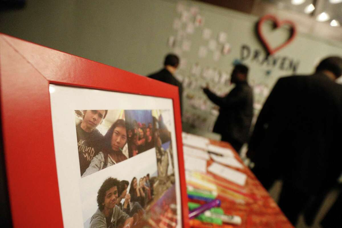 Draven McGill, pictured at the upper left corner of the frame photos, was placed on a table for people to write notes and hang on clothesline at a memorial held on Saturday, Dec. 10, 2016 in San Francisco. Orchestral performance at Ruth Asawa School of the Arts to honor 17-year-old Draven McGill, a junior at the school who was one of the Oakland fire victims and is the son of a sheriff for the Alameda County Sheriff's Office.