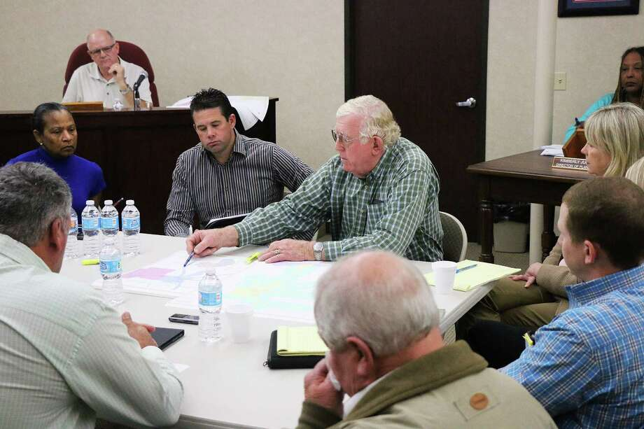 Eddie Gray, center, shows plans to Dayton City Council for his development of River Ranch and approximately 14,000 new homes over the next 10-15 years in the Dayton area. Photo: David Taylor