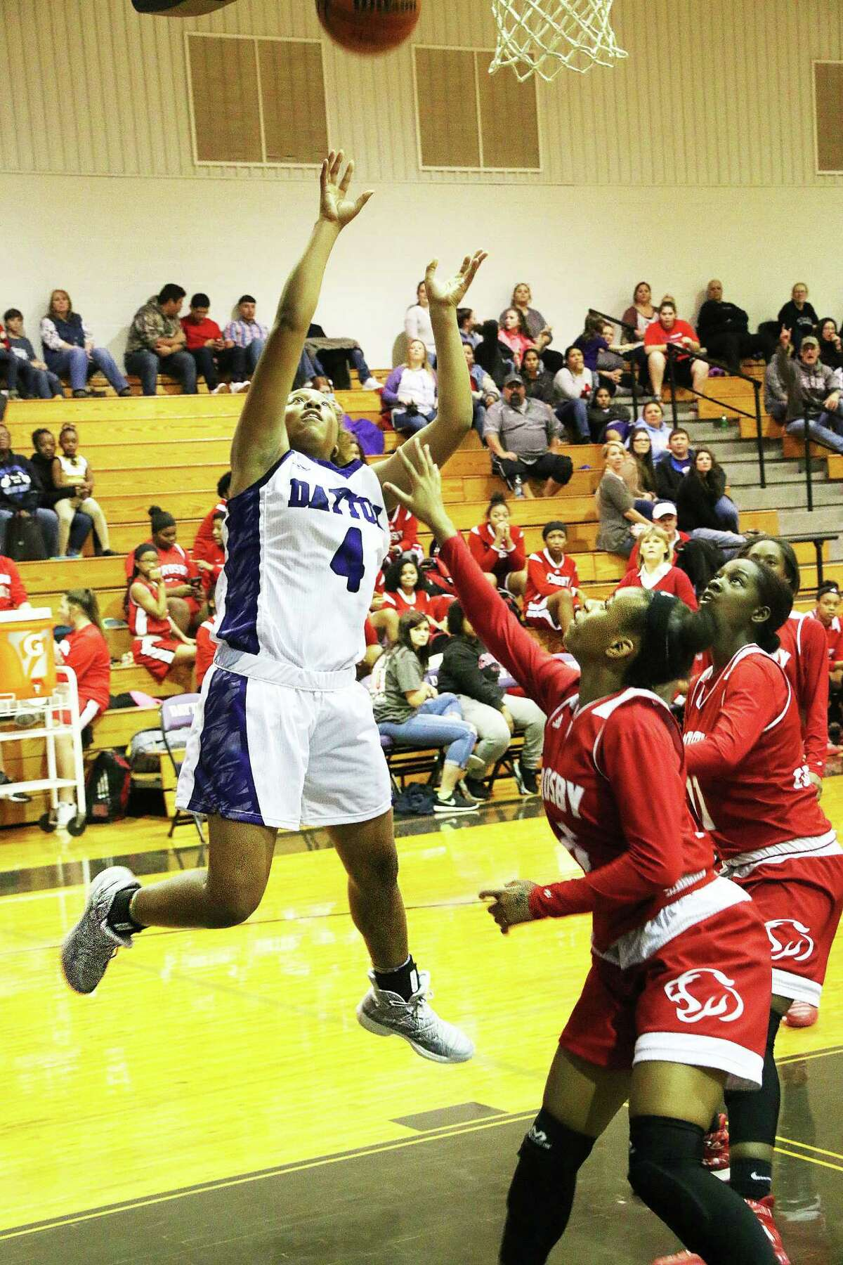 Junior guard Tayelin Grays takes the ball to the basket in the Lady Broncos win over rival Crosby last Friday night. Grays finished the night with 27 points, 9 assists and 14 rebounds.