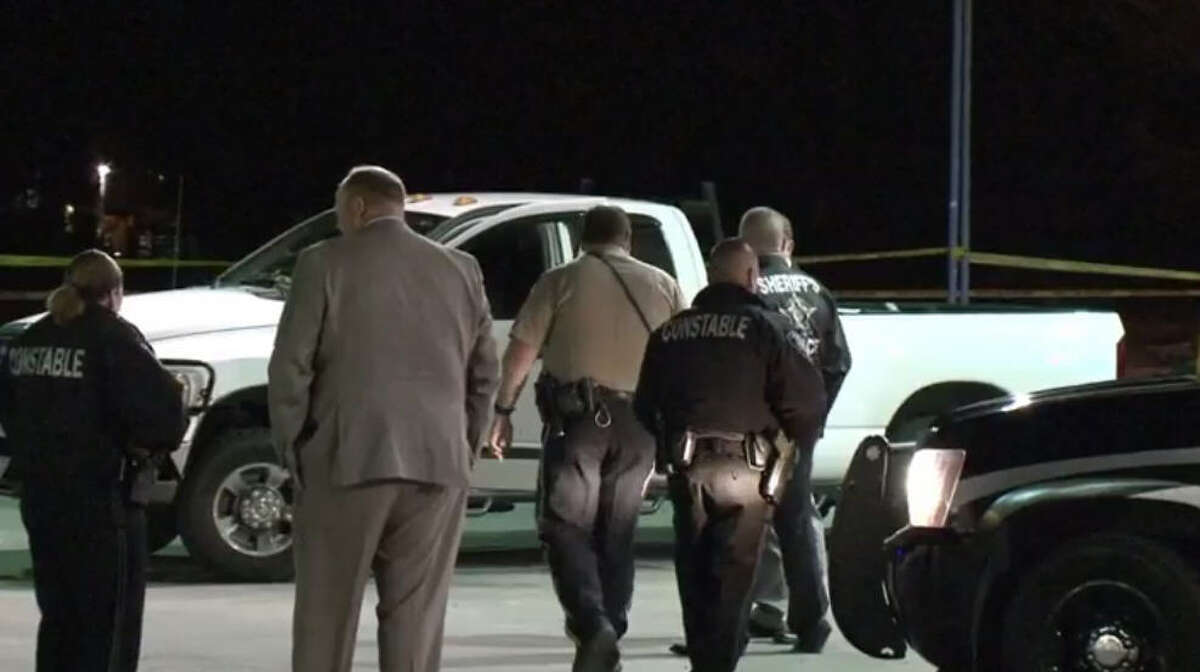 Investigators combed the scene after a deputy and his wife opened fire on two accused attackers at a Porter gas station.