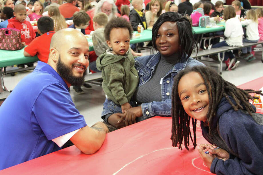 Coldspring Intermediate 3rd grader Kahlil Massie was excited to have lunch with his mom and dad, Damon and Sheila Massie, and little brother Mekhi at the Christmas Luncheon on Thursday, Dec. 8. Photo: Submitted