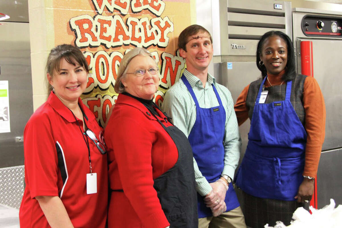 COCISD administrators gave the gift of service as they helped on the food line at Coldspring Intermediate for the 2016 Christmas Luncheon on Thursday, Dec. 9. Pictured from left to right: Child Nutrition Director Dawn Smith, Special Programs Director Cherie Meroney, Asst. Superintendent of Business and Operations Adam Jenke and Executive Director of Curriculum and Instruction Vikki Curry.