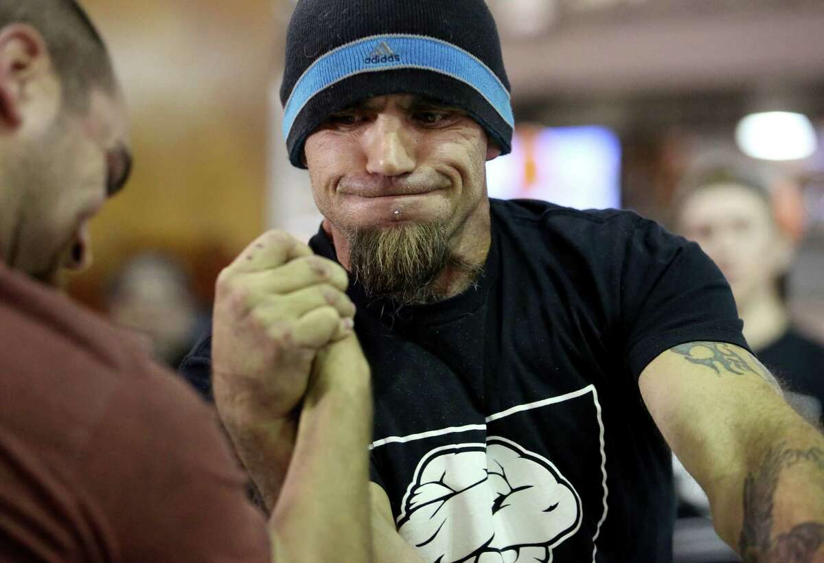 Bradley Blackwell shows his intensity during his armwrestling match with Derek Grimm on Saturday.