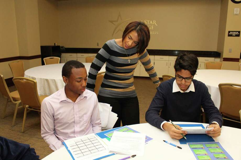 Catherine Motte, a global recruiting specialist with ExxonMobil, shares advice about career pathways with Westfield High School student Corey Richardson, seated left, and Carl Wunsche Senior High School student Christopher Ruiz. Photo: Submitted