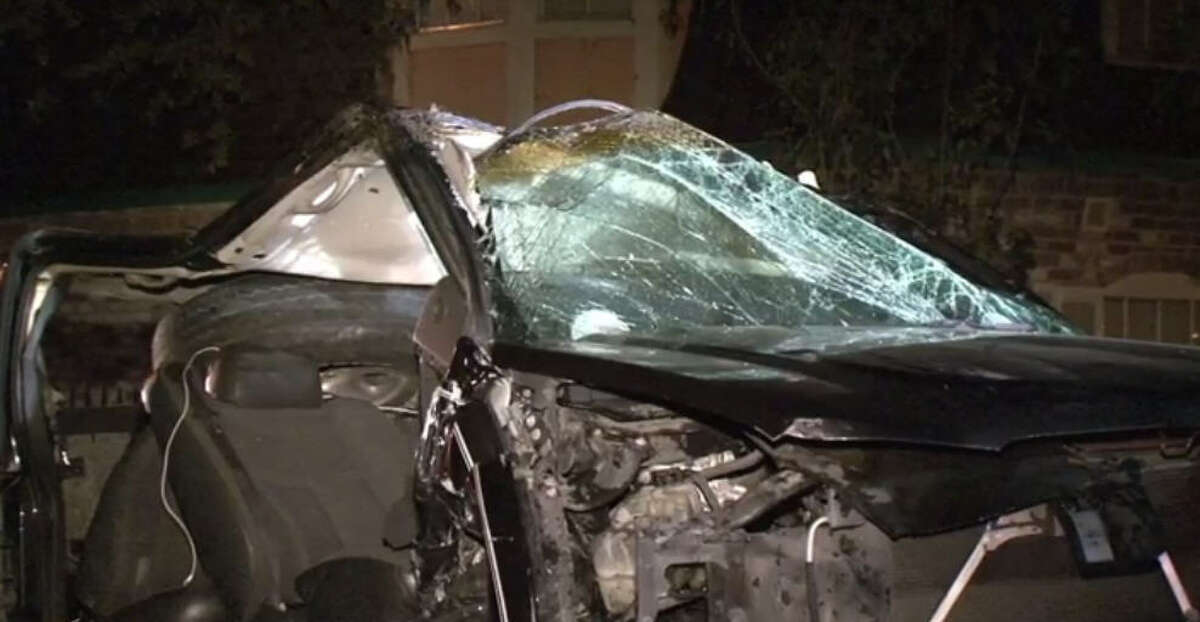 A car was destroyed in an alleged drunk driving accident Sunday morning.
