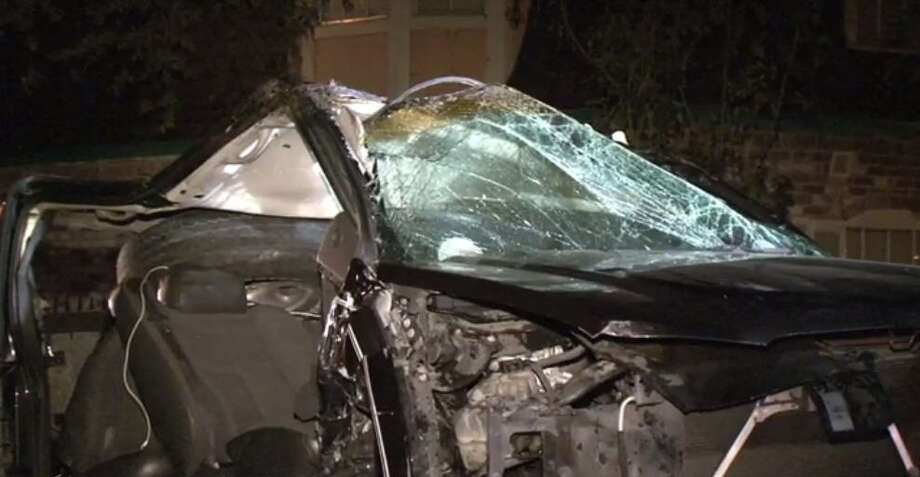 A car was destroyed in an alleged drunk driving accident Sunday morning. Photo: Metro Video