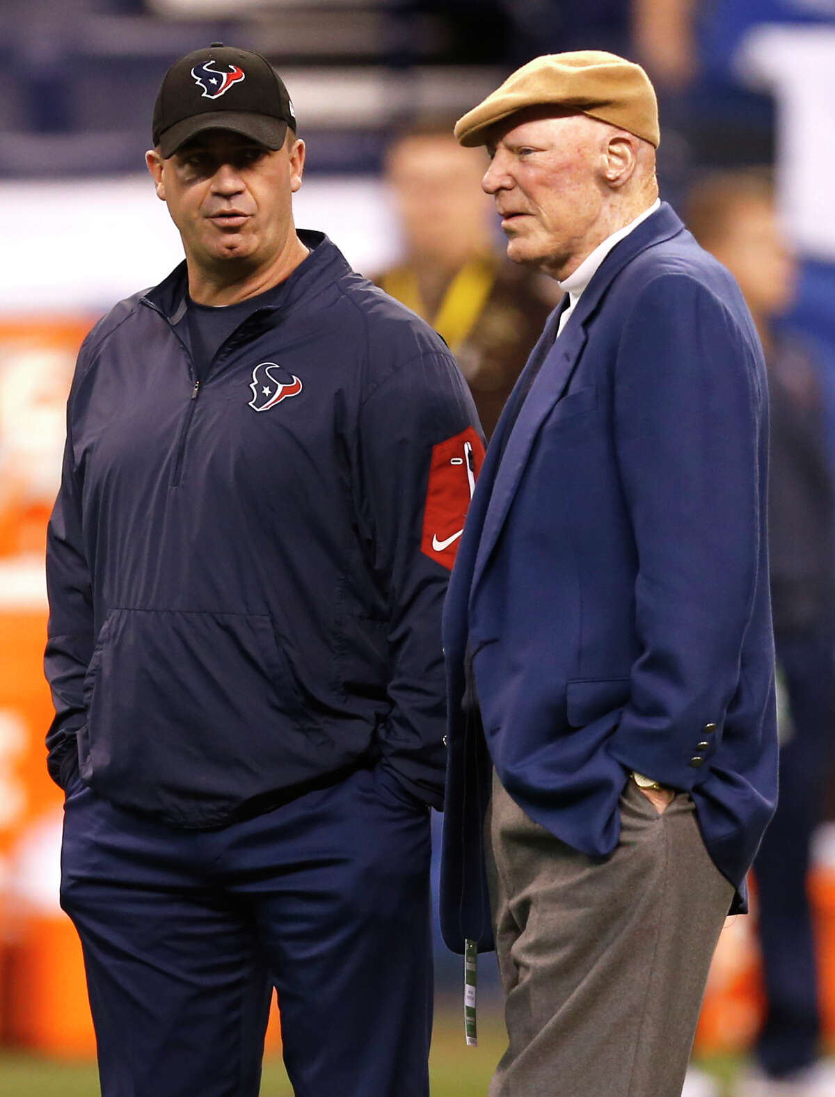 Houston Texans head coach Bill O'Brien stands with owner Bob McNair before an NFL football game against the Indianapolis Colts at Lucas Oil Stadium on Sunday, Dec. 11, 2016, in Indianapolis.