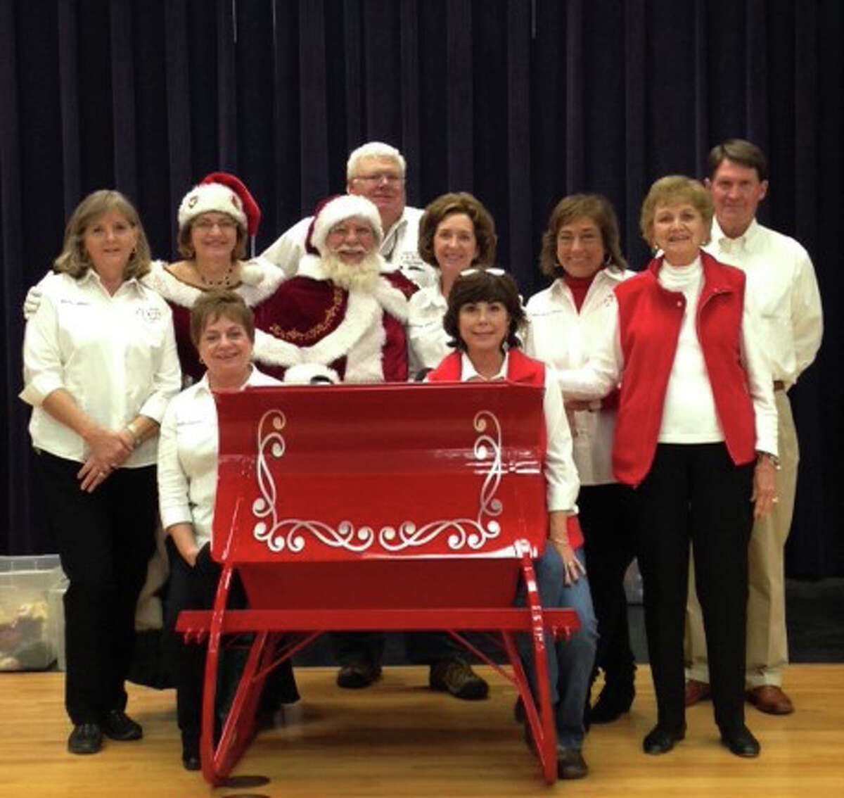 The members of the Liberty County Child Welfare Board are getting into the spirit of Christmas. Pictured left to right are (front row) Cyndie Abshire, Becky Dearmore; (middle row) Marilyn Gilliland, Mrs Claus, Santa, Donna Hebert, Mary Kay Hicks, Ena Stoesser; and (back row) Wendell Null, Dr David Arnold. Not pictured are John Hebert and Donna Burt.