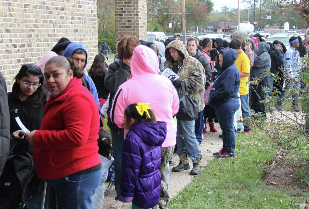 A long line of people waits outside of the Family Life Center on Dec. 10 for the Angel Select Toy Drive hosted by Repair the Breach.