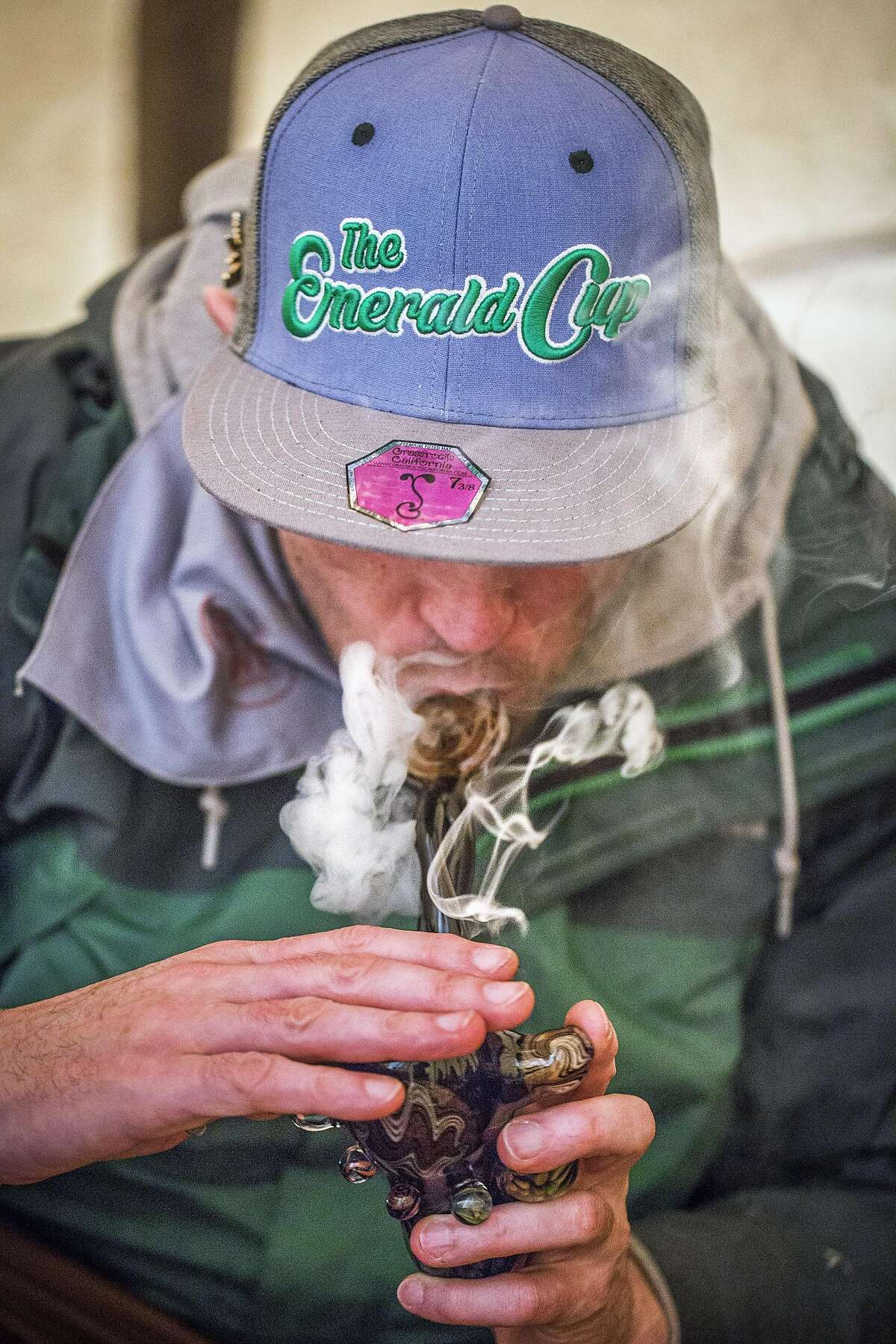 Zelly Rock takes a hit of weed inside a teepee Saturday, Dec. 10, 2016 in Santa Rosa, CA at the Emerald Cup -- a 30,000 person cannabis county fair; the world's largest. This is the first big pot party since Prop 64 has passed, ad out angle is focusing on the newcomers to the massive, sprawling event.