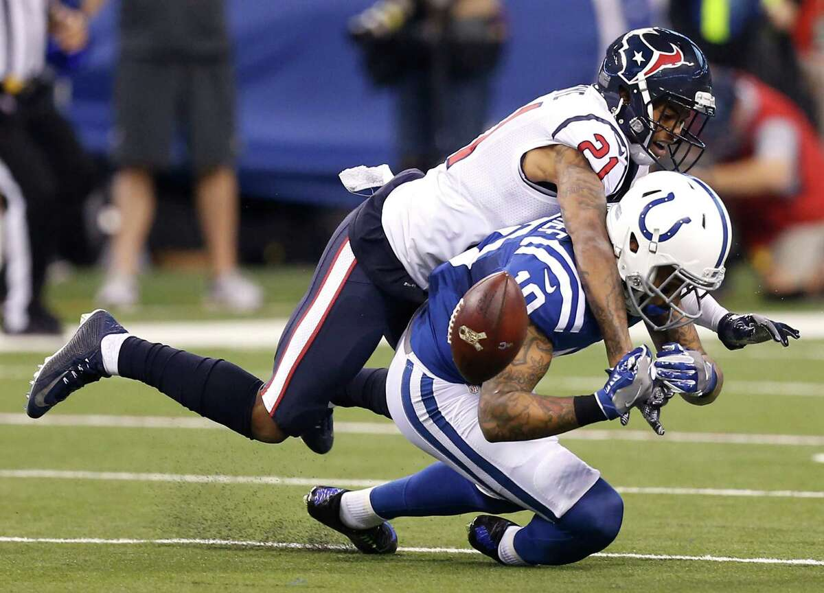 Houston Texans cornerback A.J. Bouye (21) breaks up a pass intended for Indianapolis Colts wide receiver Donte Moncrief (10) during the second quarter of an NFL football game at Lucas Oil Stadium on Sunday, Dec. 11, 2016, in Indianapolis.