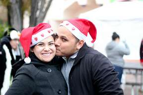 San Antonio puckered up this weekend to set the Guinness World Record of most couples to kiss under mistletoe at Six Flags Fiesta Texas on Saturday, Dec. 10, 2016.