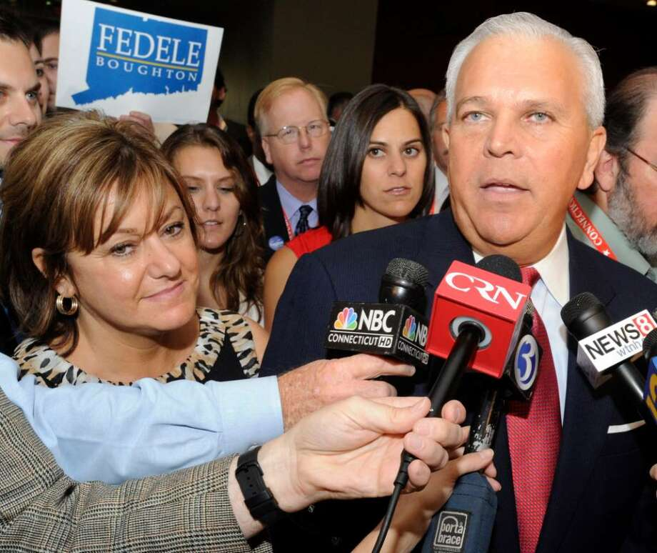 Michael Fedele with his wife Carol, addresses the press, after failing to win the Republican nomination for governor at the Republican State Convention Saturday in Hartford. Photo: Carol Kaliff / The News-Times