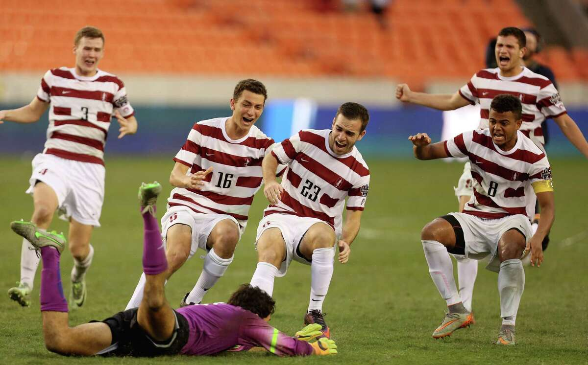 Stanford goalie Andrew Epstein (1) slides into the field to celebrate with his teammates after blocking a penalty shoot-out from Wake Forest Brad Dunwell (12) and helps the team to win the NCAA Men's College Cup Championship game at BBVA Compass Stadium Sunday, Dec. 11, 2016, in Houston. Stanford University beat Wake Forest 5-4.