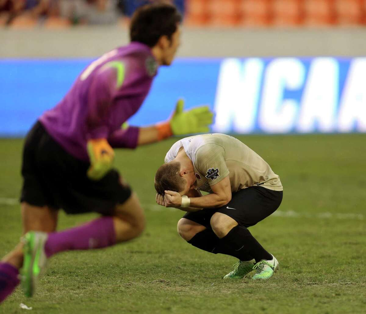 Wake Forest Brad Dunwell (12) gets upset with himself after failed to score during penalty kick-shootout and his team lost to Stanford University at the NCAA Men's College Cup Championship game at BBVA Compass Stadium Sunday, Dec. 11, 2016, in Houston. Stanford University beat Wake Forest over penalty shoot-out 5-4.