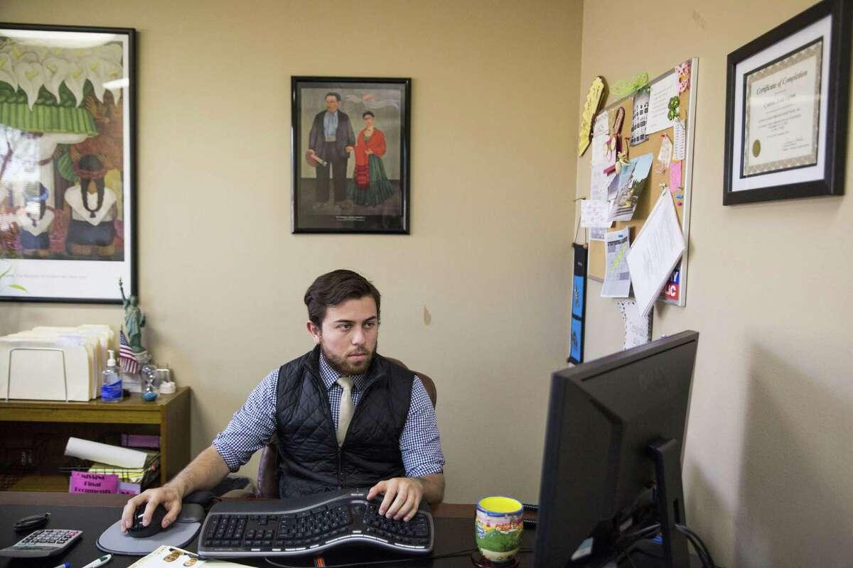 Carlos Aguilar works on an application at the De Mott, McChesney, Curtright & Armendariz LLP law firm in San Antonio, Texas on November 29, 2016.