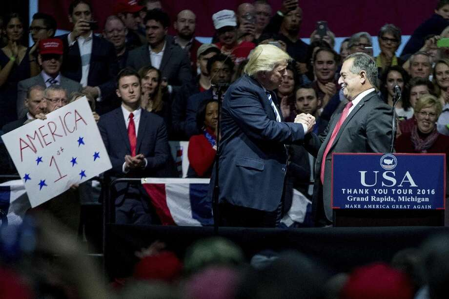 FILE — Then President-elect Donald Trump, left, thanks The Dow Chemical Co. Chairman and Chief Executive Officer Andrew Liveris, right, after speaking at a rally at DeltaPlex Arena, Friday, Dec. 9, 2016, in Grand Rapids, Mich. (AP Photo/Andrew Harnik) Photo: (AP Photo/Andrew Harnik)