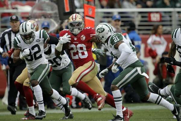 Carlos Hyde (28) runs for 43 yards in the first half as the San Francisco 49ers played the New York Jets at Levi's Stadium in Santa Clara, Calif., on Sunday, December 11, 2016.