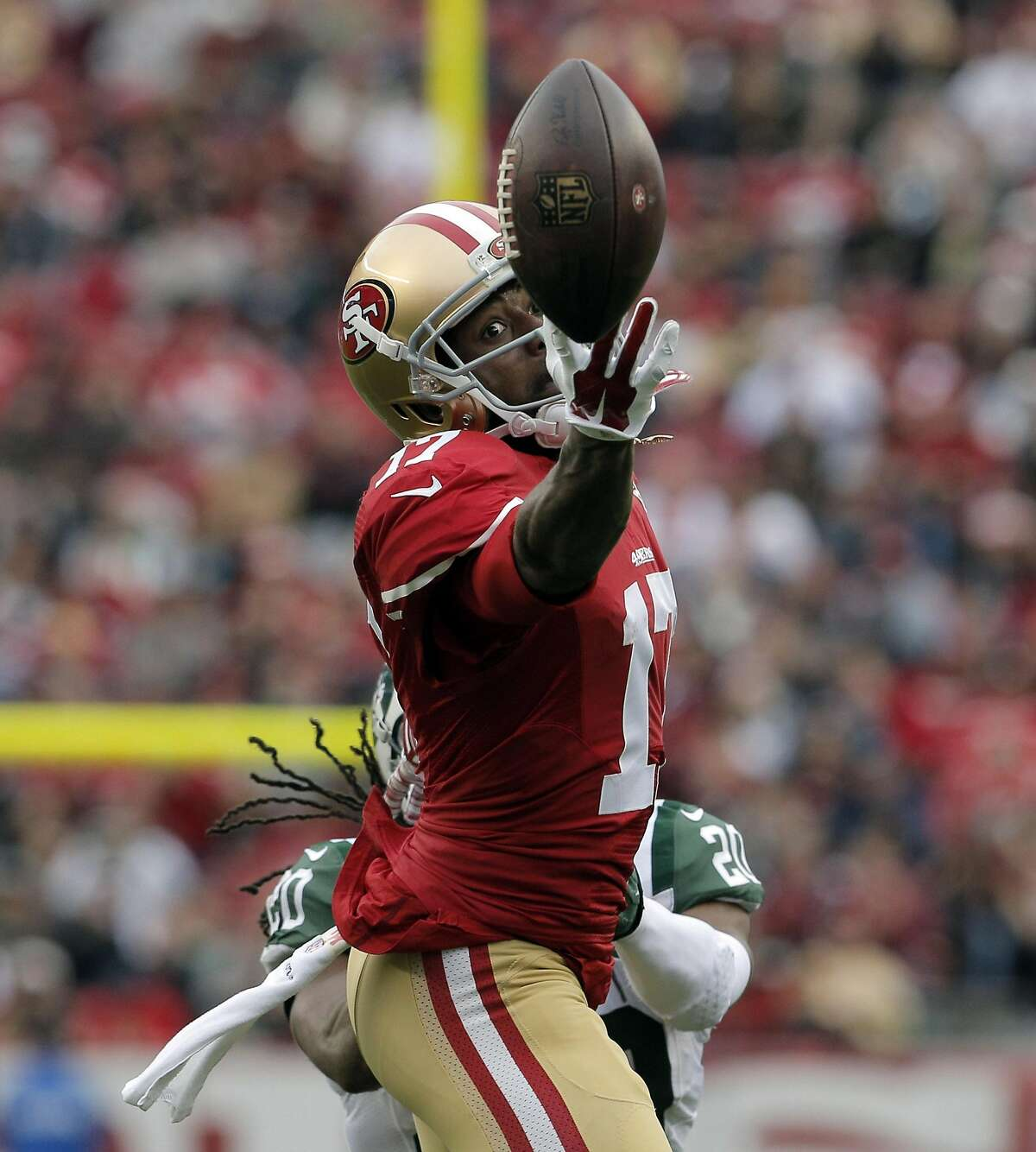 Jeremy Kerley (17) can't reach a pass from Colin Kaepernick (7) in the first half as the San Francisco 49ers played the New York Jets at Levi's Stadium in Santa Clara, Calif., on Sunday, December 11, 2016.