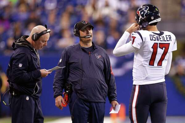 Houston Texans quarterback Brock Osweiler (17) walks to the sidelines to talk to offensive coordinator George Godsey and head coach Bill O'Brien during the third quarter of an NFL football game at Lucas Oil Stadium on Sunday, Dec. 11, 2016, in Indianapolis.