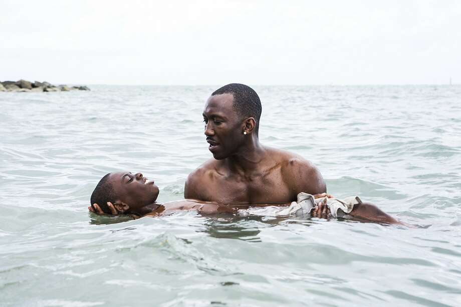 "This image released by A24 shows Alex Hibbert, foreground, and Mahershala Ali in a scene from the film, ""Moonlight."" The 74th annual Golden Globe nominations will be streamed live online, beginning at 8:10 a.m. EST. Among the films expected to take in a number of nods are Damien Chazelle's nostalgic Los Angeles musical ""La La Land,"" Barry Jenkins' lyrical coming-of-age tale ""Moonlight,"" and Kenneth Lonergan's New England drama ""Manchester by the Sea."" (David Bornfriend/A24 via AP) Photo: David Bornfriend, Associated Press"