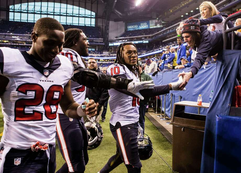 PHOTOS: How John McClain graded the Texans after their win over the ColtsA Houston Texans fan high fives Houston Texans wide receiver DeAndre Hopkins (10) and he, running back Alfred Blue (28) and defensive end Jadeveon Clowney (90) leave the field after the Texans beat the Indianapolis Colts 22-17 during the fourth quarter of an NFL football game at Lucas Oil Stadium on Sunday, Dec. 11, 2016, in Indianapolis.Browse through the photos above to see how John McClain graded each position group after the Texans' win. Photo: Brett Coomer, Houston Chronicle / © 2016 Houston Chronicle
