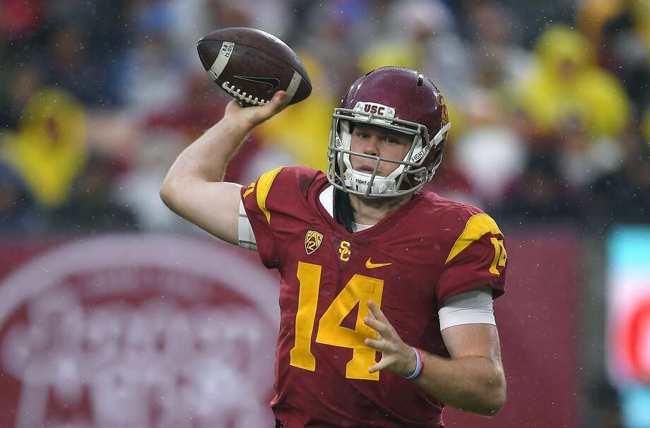 FILE - In this Nov. 26, 2016, file photo, Southern California quarterback Sam Darnold passes during the first half of an NCAA college football game against Notre Dame in Los Angeles. Darnold was a unanimous choice as newcomer of the year on the Associated Press All-Pac-12 team announced on Friday, Dec. 9, 2016. (AP Photo/Mark J. Terrill File) Photo: Mark J. Terrill, Associated Press