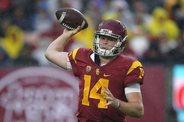 FILE - In this Nov. 26, 2016, file photo, Southern California quarterback Sam Darnold passes during the first half of an NCAA college football game against Notre Dame in Los Angeles. Darnold was a unanimous choice as newcomer of the year on the Associated Press All-Pac-12 team announced on Friday, Dec. 9, 2016. (AP Photo/Mark J. Terrill File)