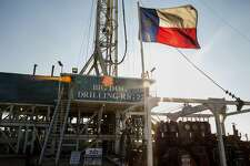 The Texas flag flies at Endeavor Energy Resources's Big Dog Drilling Rig 22 in the Permian basin outside of Midland, Texas, on Dec. 12, 2014. MUST CREDIT: Bloomberg photo by Brittany Sowacke.