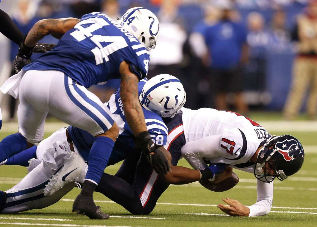 Houston Texans quarterback Brock Osweiler (17) is sacked by Indianapolis Colts outside linebacker Trent Cole (58) during the fourth quarter of an NFL football game at Lucas Oil Stadium on Sunday, Dec. 11, 2016, in Indianapolis.