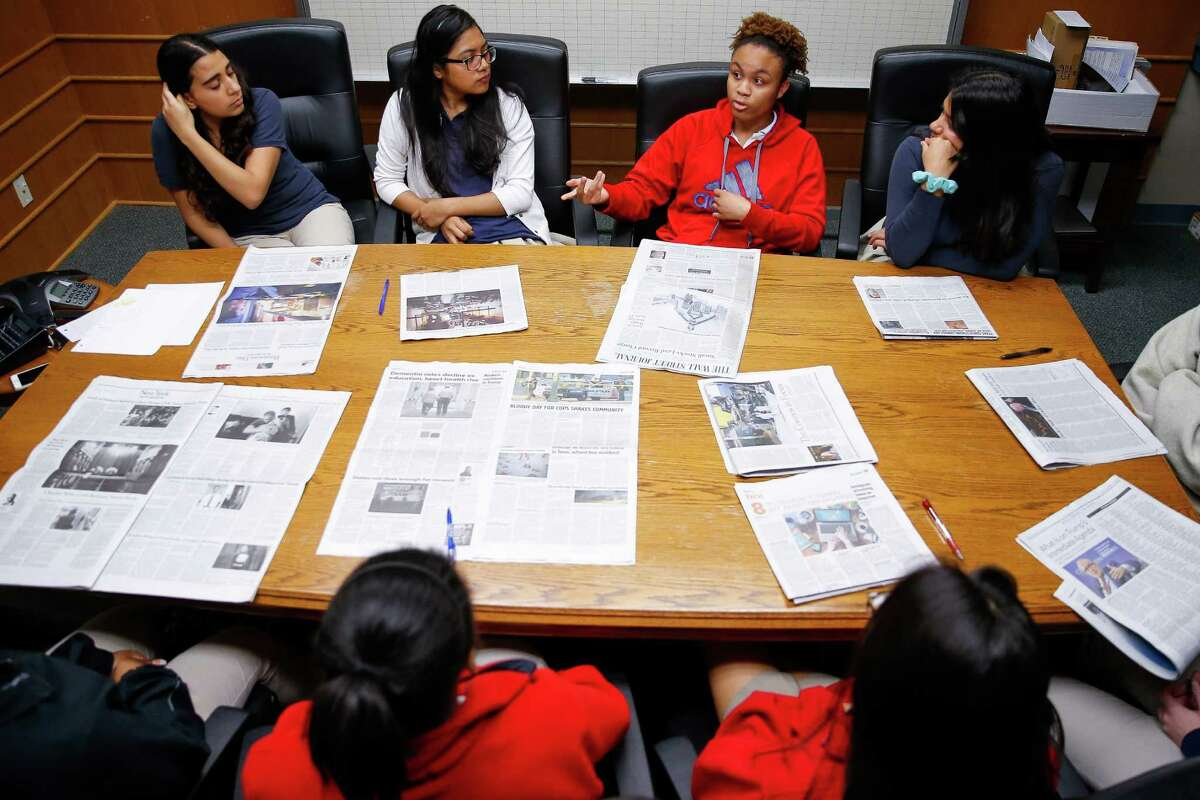 Lamar High School senior Kayla Houston, second from right, talks about an article she read during Women on the Way Up, a mentoring program for high-achieving girls from low-income backgrounds, at Lamar High School Tuesday, Nov. 22, 2016 in Houston.