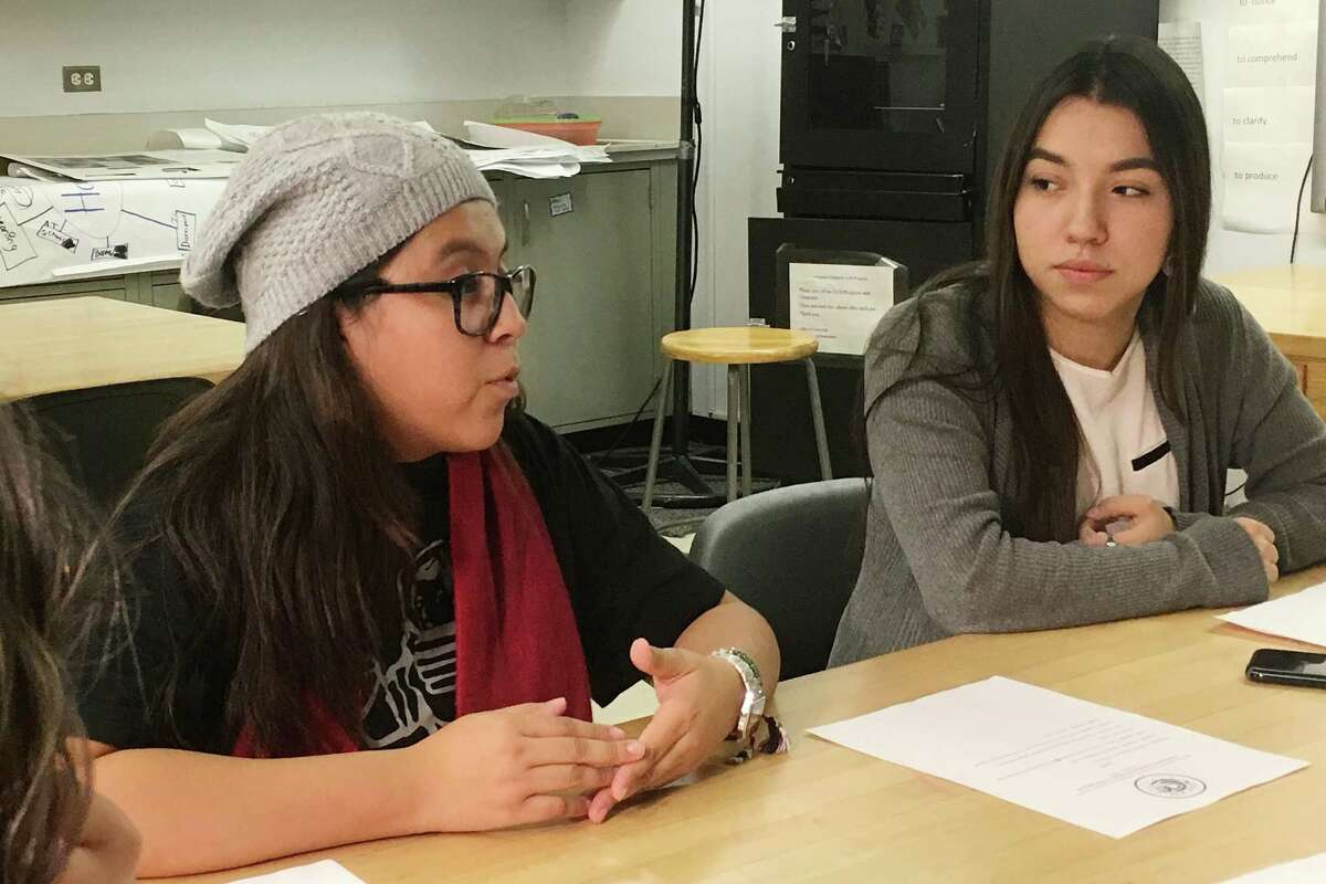 In this photo taken Dec. 1, 2016, Mexican students Yatziri Tovar, left, and Roxanna Herrera, discuss their travel plans at City College of New York. Young immigrants who live illegally in the country and are traveling abroad have been advised to return to the U.S. before Donald Trump is sworn in as president on January 20th. Some advocates, lawyers and universities say they fear that if the immigrants go overseas they might not be allowed to re-enter the U.S. because the president-elect promised during his campaign to immediately scrap the program that protects them. (AP Photo/Claudia Torrens)