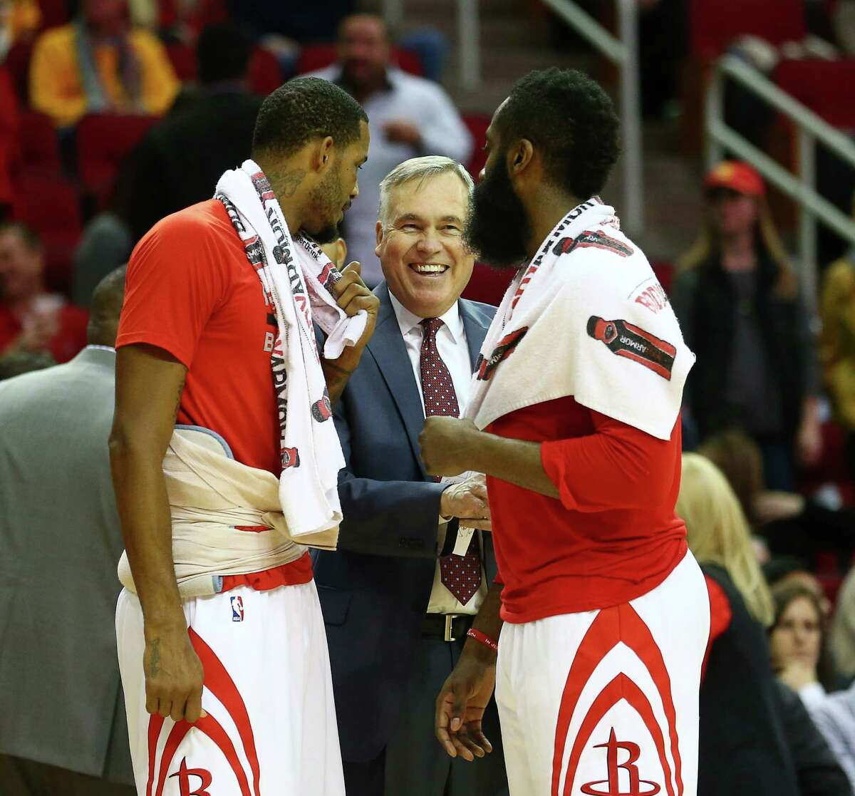 Rockets coach Mike D'Antoni, center, talks with Trevor Ariza, left, and James Harden. D'Antoni says the team is all-in every day, making coaching fun.