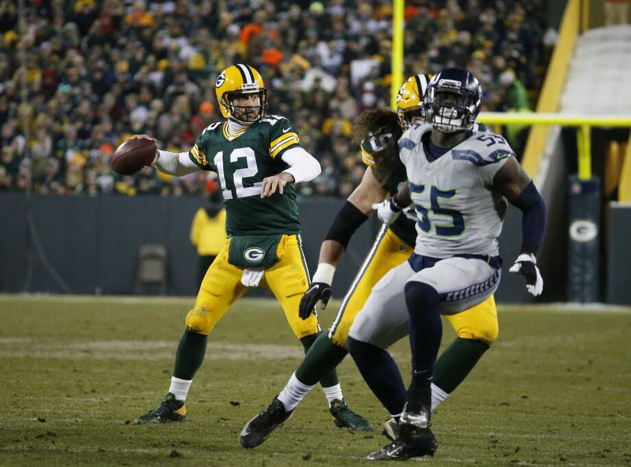 Green Bay Packers' Aaron Rodgers throws during the second half of an NFL football game against the Seattle Seahawks Sunday, Dec. 11, 2016, in Green Bay, Wis. (AP Photo/Mike Roemer) Photo: Mike Roemer/AP