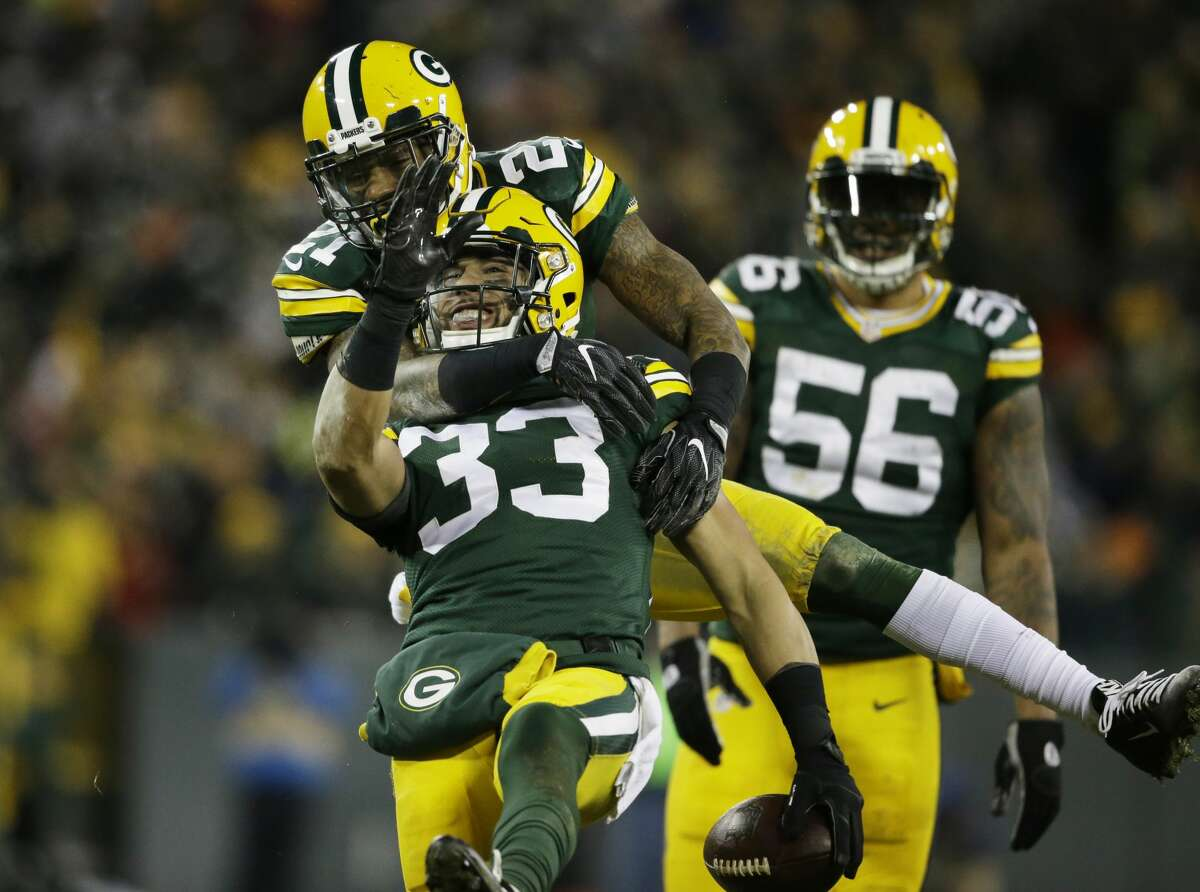 Green Bay Packers' Ha Ha Clinton-Dix congratulates teammate Micah Hyde (33) after Hyde's interception during the second half of an NFL football game against the Seattle Seahawks Sunday, Dec. 11, 2016, in Green Bay, Wis. (AP Photo/Jeffrey Phelps)