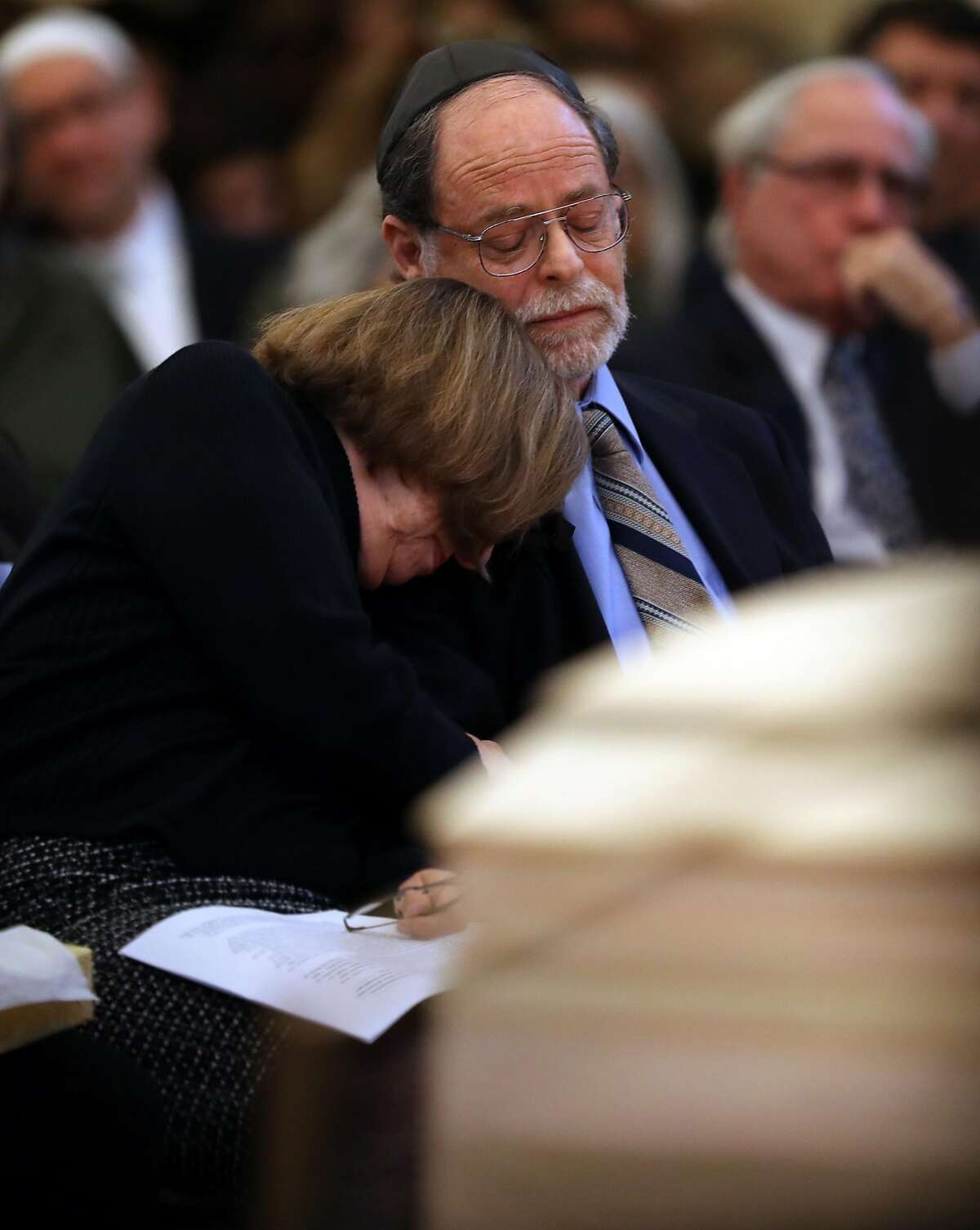 Ed Bernbaum comforts his wife, Diane, during the funeral for their son, Jonathan Bernbaum, a Ghost Ship warehouse fire victim, at Congregation Beth El in Berkeley, Calif., on Sunday, December 11, 2016.
