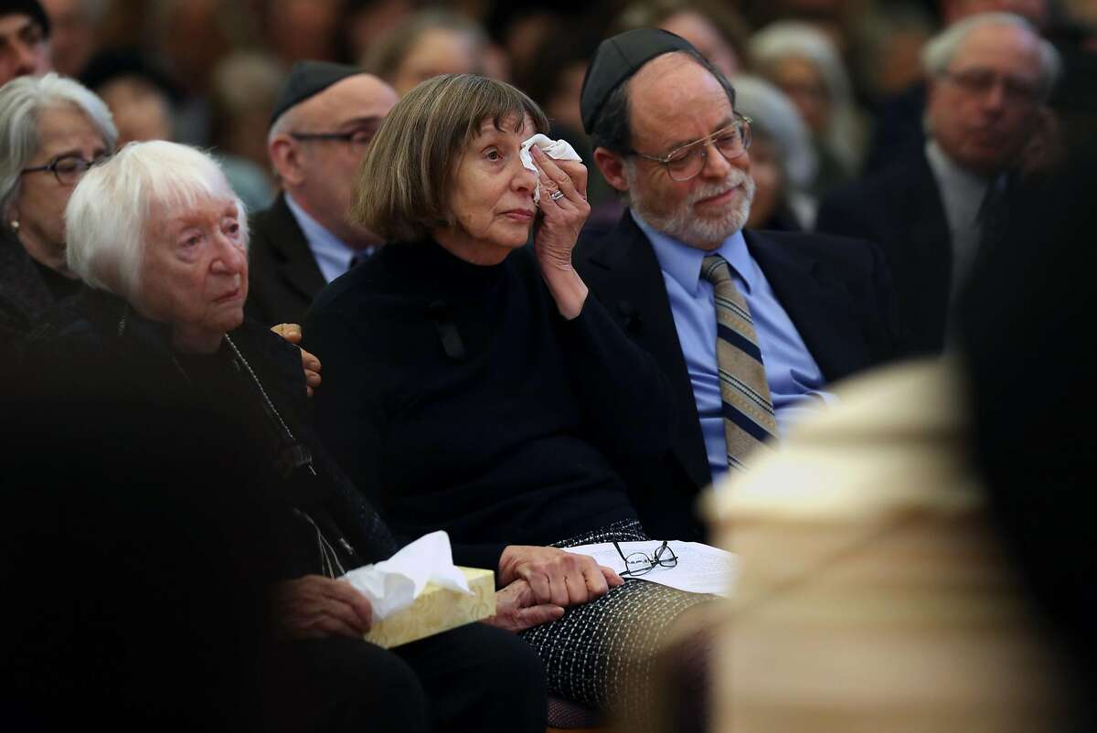 Diane Bernbaum wipes away a tear during the funeral for her son, Jonathan Bernbaum, a Ghost Ship warehouse fire victim, at Congregation Beth El in Berkeley, Calif., on Sunday, December 11, 2016.
