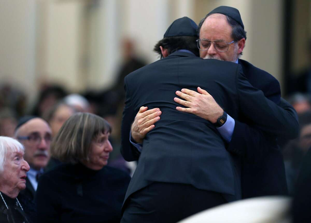 Ed Bernbaum hugs his son, David, during the funeral for his other son, Jonathan Bernbaum, a Ghost Ship warehouse fire victim, at Congregation Beth El in Berkeley, Calif., on Sunday, December 11, 2016.