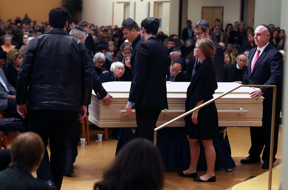 The casket of Ghost Ship warehouse fire victim Jonathan Bernbaum is carried out after Bernbaum's funeral at Congregation Beth El in Berkeley, Calif., on Sunday, December 11, 2016.
