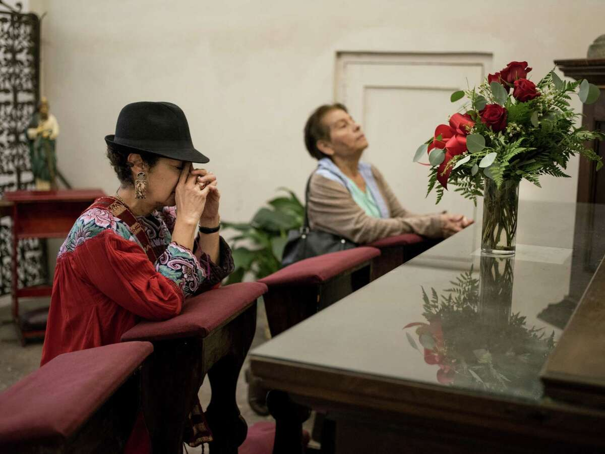 Terry Yba-ez, left, president of the Mission San Jose Neighborhood Association, and her aunt Janie Sepulveda, right, pray together at Mission San Jose during a mission pilgrimage that started from Mission Concepci-n and made stops at missions San Jose, San Juan and finished at Mission Espada on Sunday, December 11, 2016. The walk is meant to honor the feast day of La Virgen de Guadalupe (Our Lady of Guadalupe) and to bring awareness to the protection of the missions from what the organizers call more commercial interests, like planned developments in close proximity to the missions.