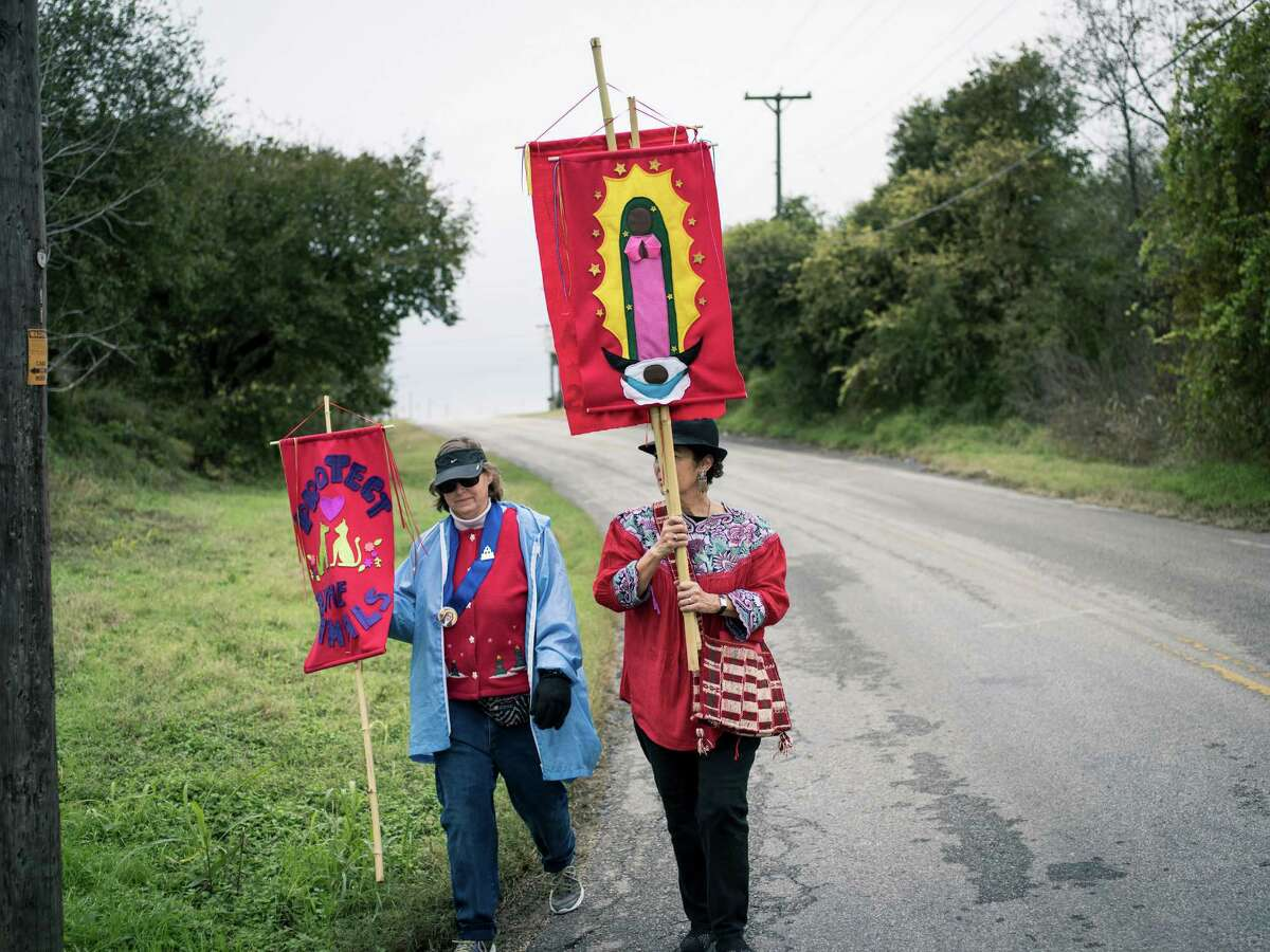 Terry Yba-ez, right, and Margaret Murphy, left, both on the Mission San Jose Neighborhood Association walk to Mission San Juan during a mission pilgrimage that started from Mission Concepci-n and made stops at missions San Jose, San Juan and finished at Mission Espada on Sunday, December 11, 2016. The walk is meant to honor the feast day of La Virgen de Guadalupe (Our Lady of Guadalupe) and to bring awareness to the protection of the missions from what the organizers call more commercial interests, like planned developments in close proximity to the missions.