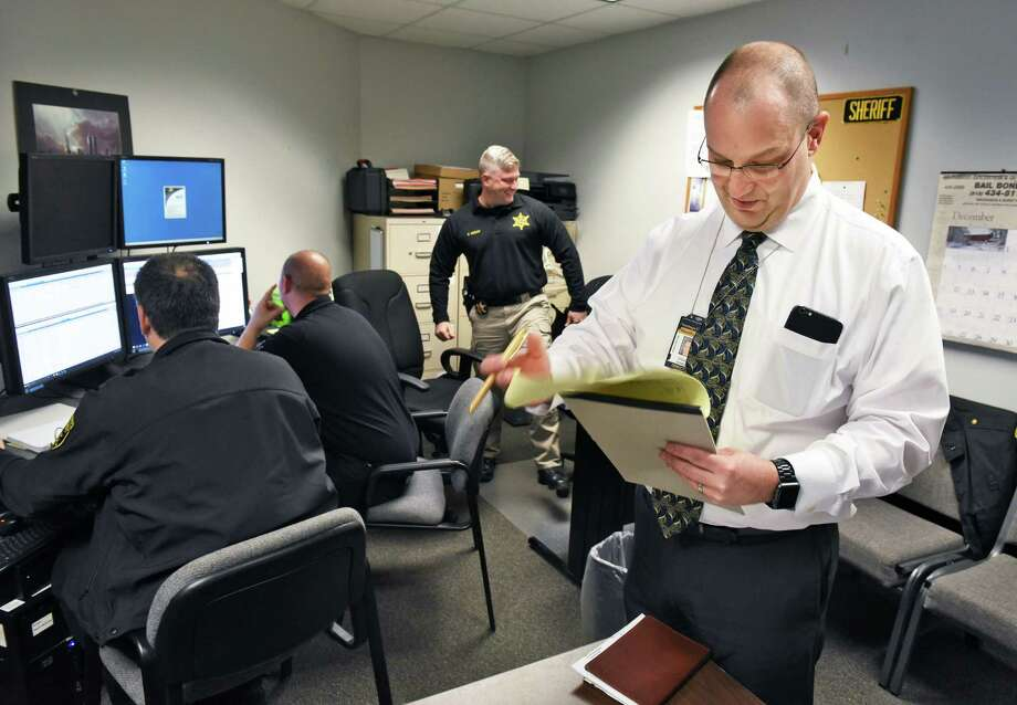 Director of emergency communications Steven Gordon, right, in the office space he shares at the Saratoga County Sheriff's department Thursday Dec. 8, 2016 in Ballston Spa, NY.  (John Carl D'Annibale / Times Union) Photo: John Carl D'Annibale / 20039100A