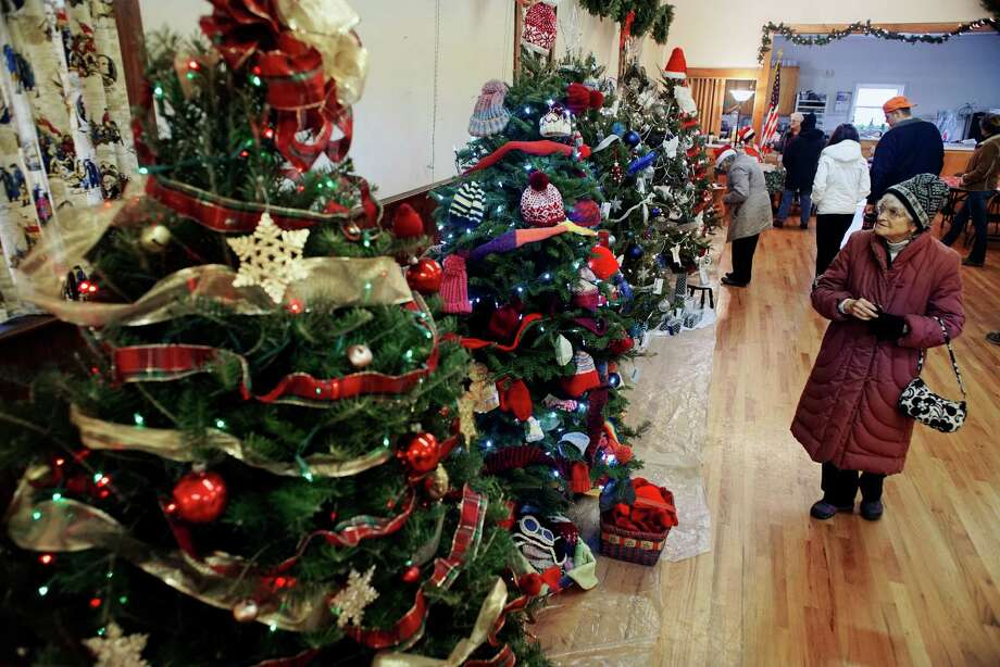 Joan Richardson of Slingerlands looks over the decorated trees that are part of the festival of trees at the Masonic Hall at the 2016 Victorian Holidays and Winter Market on Sunday, Dec. 11, 2016, in Altamont, N.Y.  The trees are decorated by local businesses and organizations.   (Paul Buckowski / Times Union) Photo: PAUL BUCKOWSKI / 20038891A