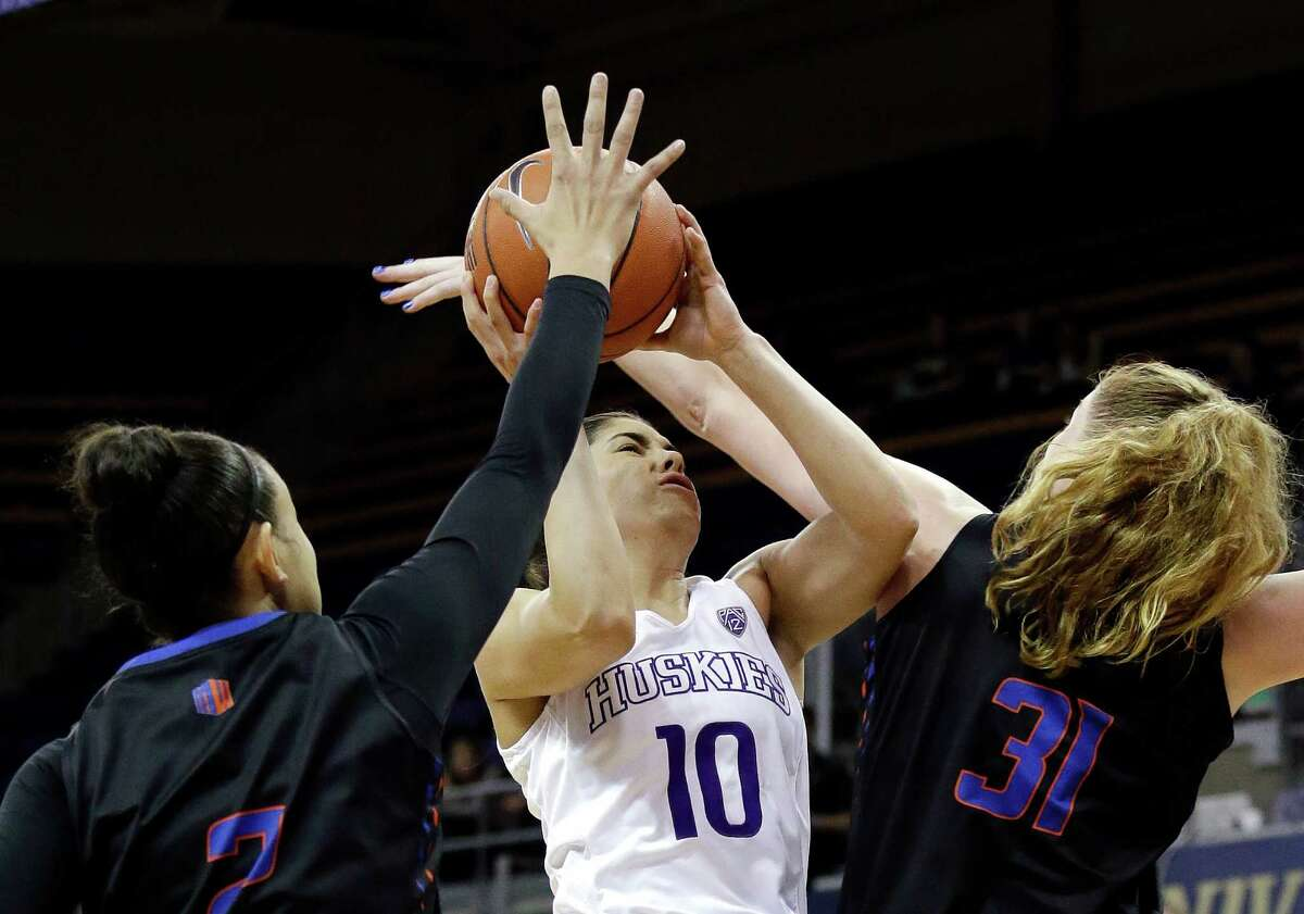 Try as they might, Boise State's Shalen Shaw, left, and Marijke Vanderschaaf could not keep Washington's Kelsey Plum (10) from matching her season high with 44 points and becoming the Pac-12's career scoring leader in the Huskies' 92-66 victory at Seattle on Sunday.