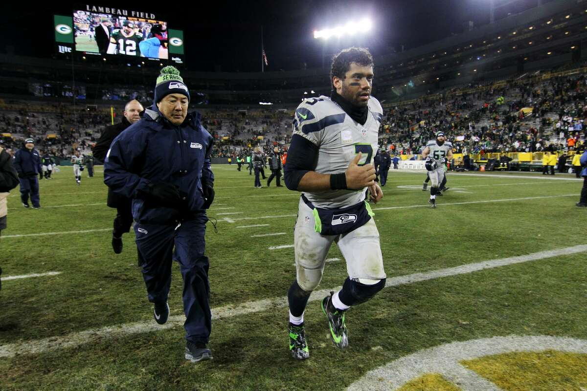 Russell Wilson of the Seattle Seahawks jogs off the field after the Green Bay Packers beat the Seattle Seahawks 38-10 at Lambeau Field on December 11, 2016 in Green Bay, Wisconsin. (Photo by Dylan Buell/Getty Images)
