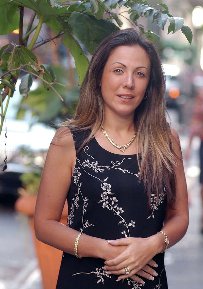 "** FILE ** Amy Fisher poses in a New York file photo from Oct. 1, 2004. More than a decade after the the 16-year-old  had a sexual relationship with a much-older car mechanic and shot his wife in the face, the one-time ""Long Island Lolita"" and Joey and Mary Jo Buttafuoco have agreed to appear together in a televised reunion, a television producer told the New York Post for Monday, Jan. 23, 2006, editions.(AP Photo/Richard Drew, File) Photo: RICHARD DREW / AP"