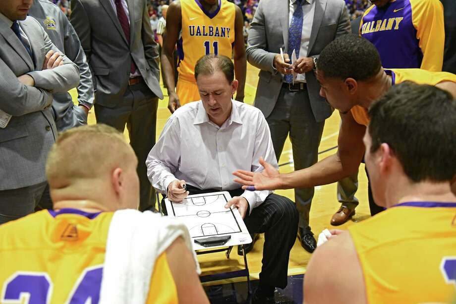 University at Albany head coach Will Brown goes over a play during a time out at the Albany Cup basketball game against Siena at UAlbany on Sunday, Nov. 27, 2016 in Albany, N.Y. (Lori Van Buren / Times Union) Photo: Lori Van Buren / 20038932A