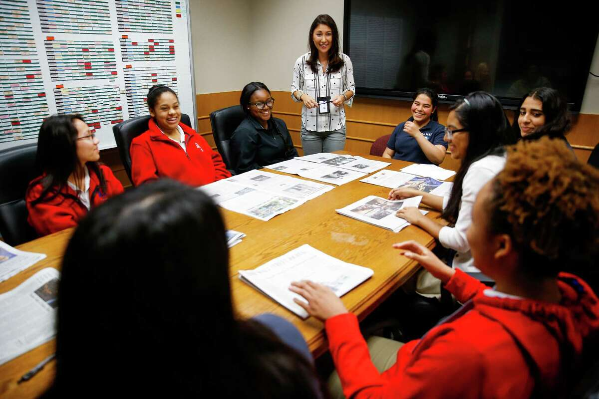 Christine Laskin, center, leads a discussion in Women on the Way Up, a mentoring program for high-achieving girls from low-income backgrounds.