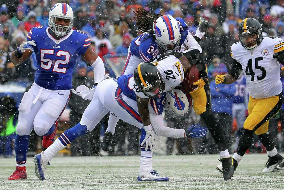 Pittsburgh Steelers running back Le'Veon Bell (26) is hit by Buffalo Bills cornerback Ronald Darby (28) and free safety Corey Graham (20) during the second half of an NFL football game, Sunday, Dec. 11, 2016, in Orchard Park, N.Y. (AP Photo/Bill Wippert) ORG XMIT: NYJC118 Photo: Bill Wippert / FR170745 AP